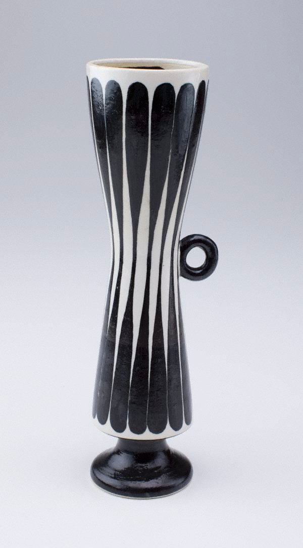 An image of Thin bottle with black lines