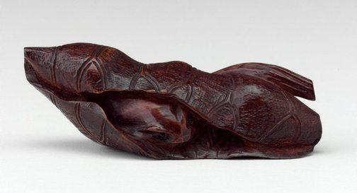 An image of Netsuke in the form of a frog in a lily leaf by
