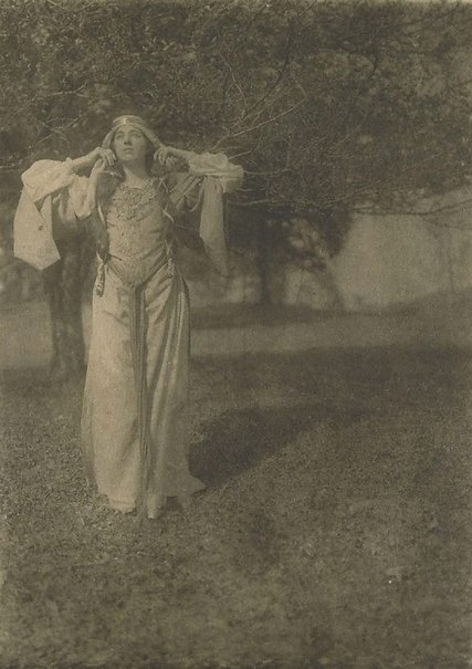 An image of Illustration no 18 (woman in medieval garb with hands raised to ears, searching in wood from Arthurian legend) from Camera Work, no 27, July 1909 by Herbert Greer French