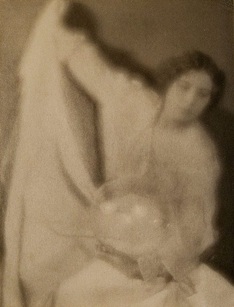 An image of Experiment 28 (lady with crystal ball in hand) 1907, from Camera Work, no 27, July 1909 by Clarence H White, Alfred Stieglitz