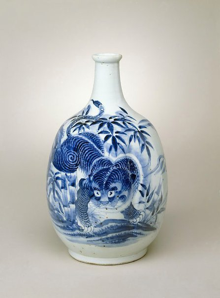 An image of Multi-lobed sake bottle with design of tiger by Arita ware