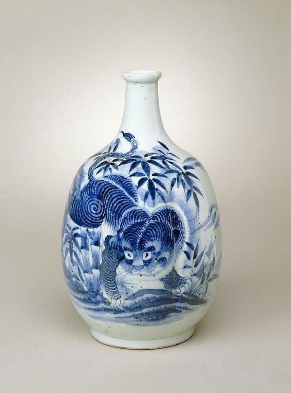 An image of Sake bottle with tiger design