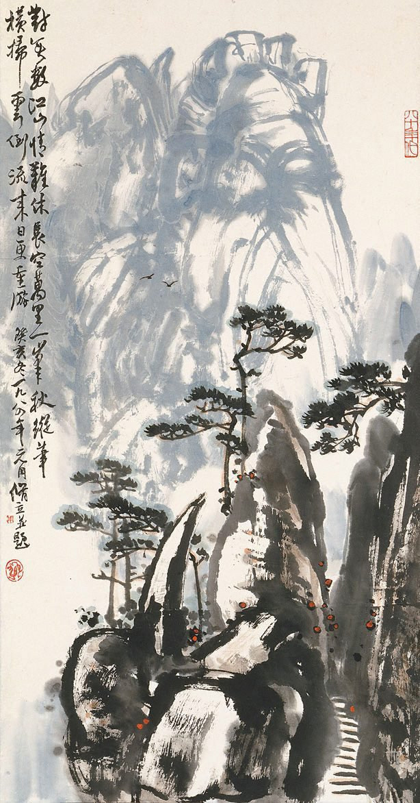 An image of Pines and mountain peaks