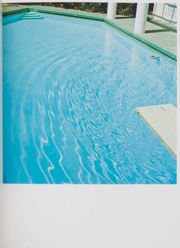 An image of Nine swimming pools and a broken glass