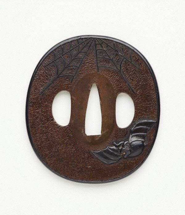 An image of Sword guard ('tsuba') with design of bat and cobweb