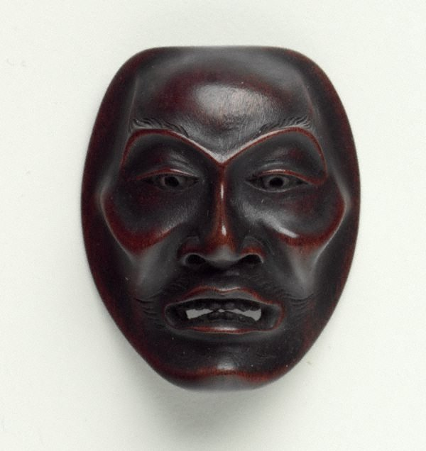 An image of Netsuke in the form of a Noh mask of 'yase-otoko' (thin man)
