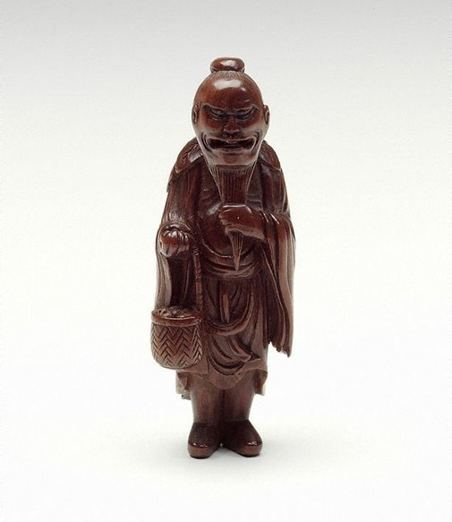 An image of Netsuke in the form of a 'sennin' with basket by
