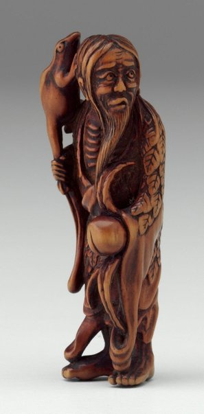 An image of Netsuke in the form of Gama 'sennin' holding a peach by