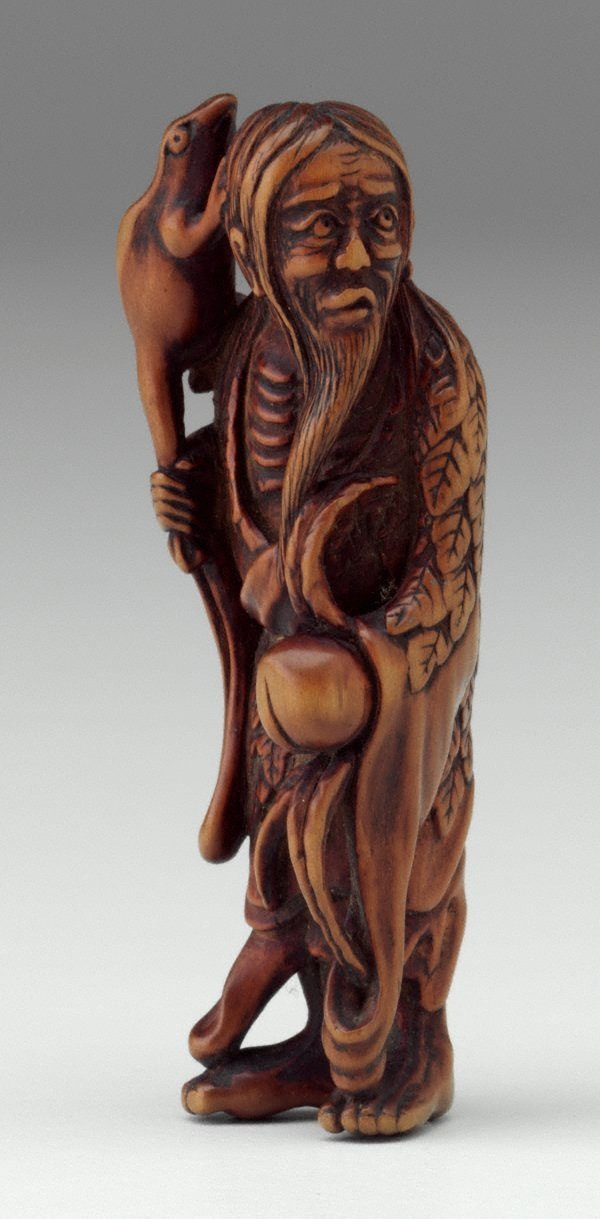 An image of Netsuke in the form of Gama 'sennin' holding a peach