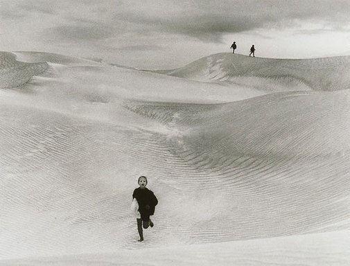 An image of Rosie in the dunes by Robert Ashton