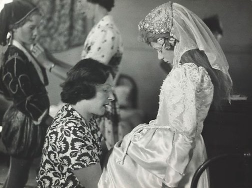 An image of Untitled (Matron helping Richard as Silvia wth his costume) by David Potts