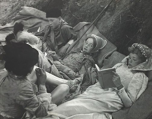 An image of Resting between scenes, these schoolboy actors catch up on their reading by David Potts