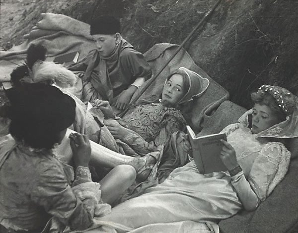 An image of Resting between scenes, these schoolboy actors catch up on their reading