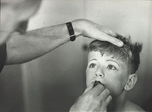 An image of Untitled (applying lipstick) by David Potts