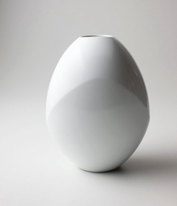 An image of White porcelain jar with flattened side