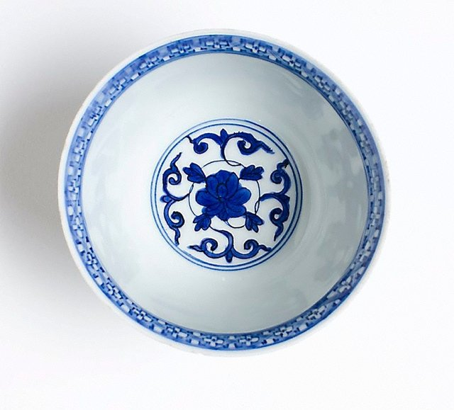 An image of Bowl with a design of phoenixes and peonies