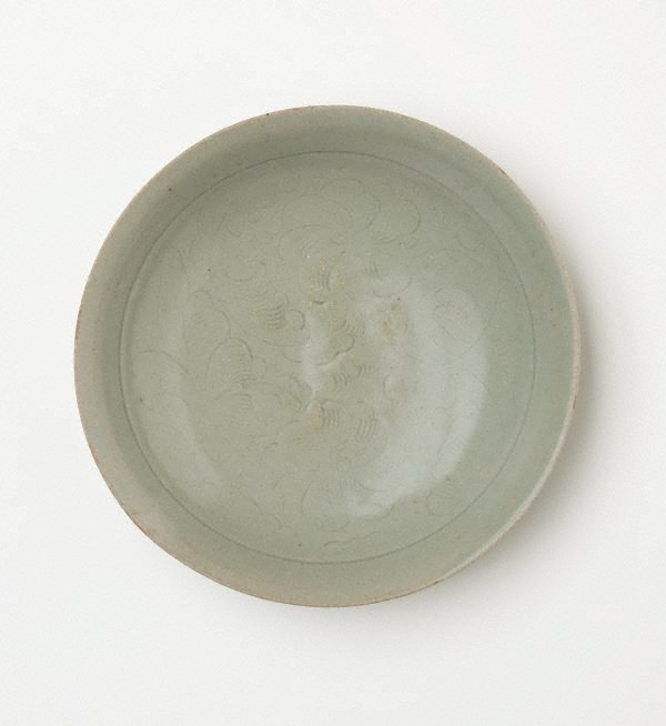 An image of Saucer with incised peony decoration