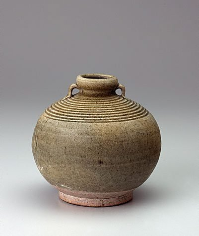 An image of Two handled globular jar with incised concentric rings on shoulder by