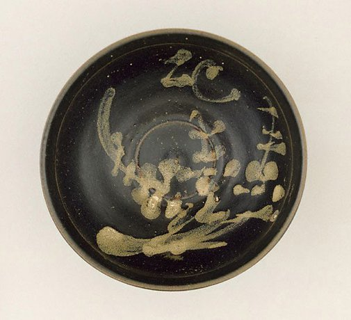 An image of Tea bowl with slip design of plum blossom by Jizhou ware
