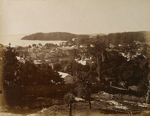 An image of Sydney scene, showing harbour and headland