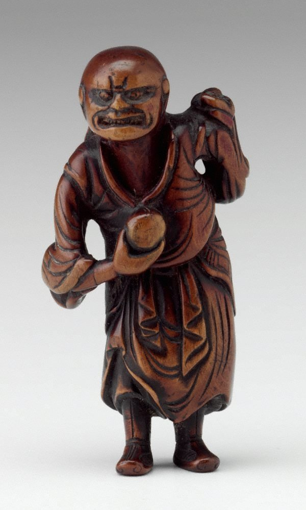 An image of Netsuke in the form of a 'sennin' with long hair