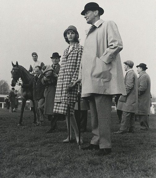 An image of Jean Shrimpton and Chris Powell, Racecourse Fashion for 'Go!' by Lewis Morley