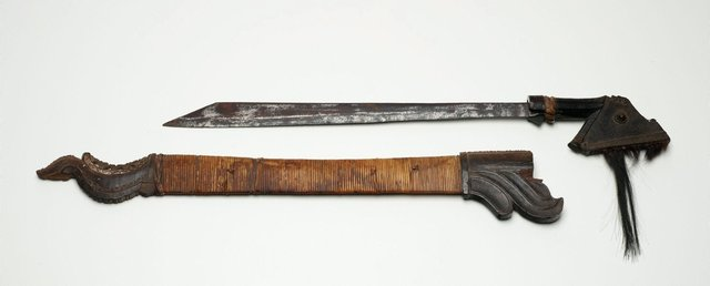 An image of Sword with scabbard (moso or rugi)