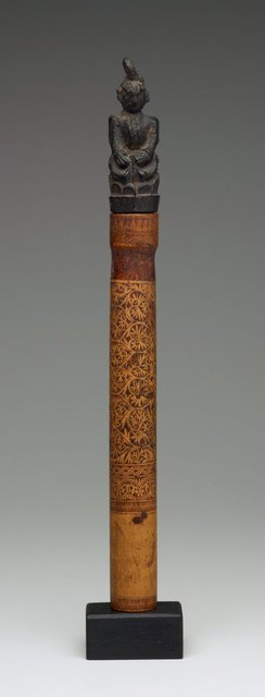 AGNSW collection Bamboo tube (solep) with stopper or charm  (karuhai) in the form of seated figure 19th century-20th century