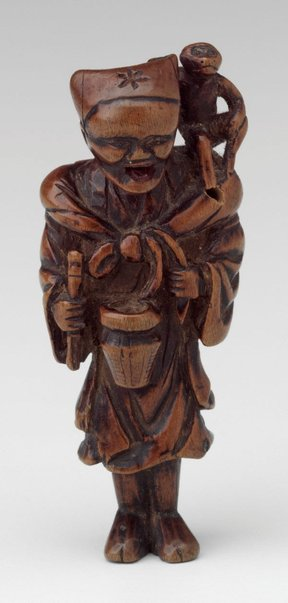 An image of Netsuke in the form of a monkey tamer by