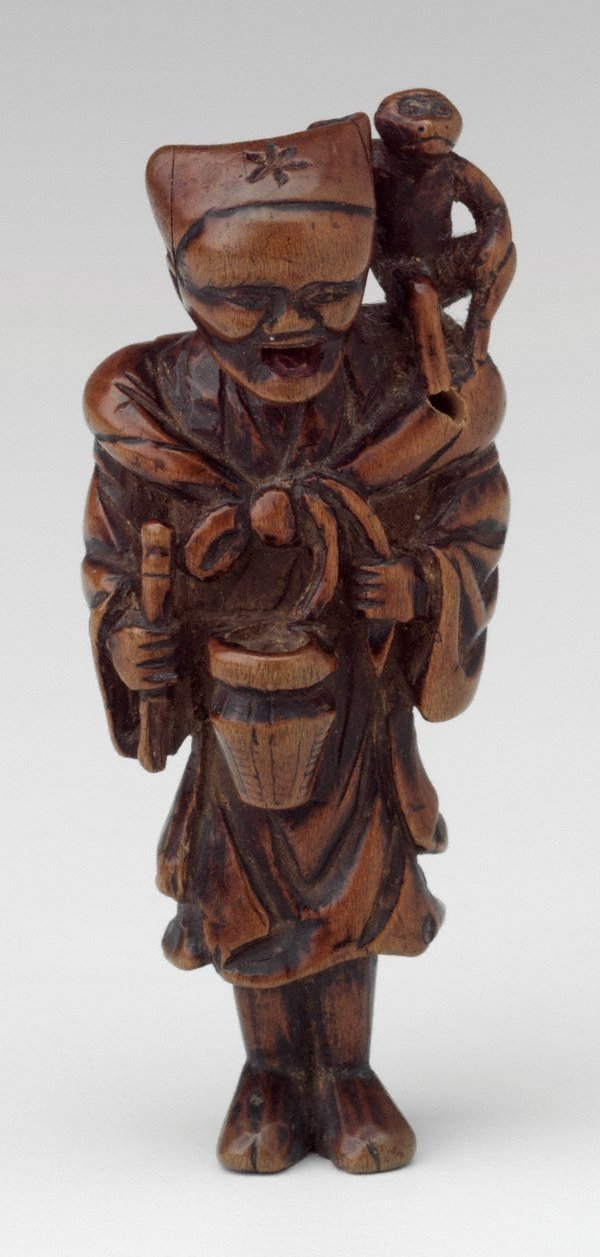 An image of Netsuke in the form of a monkey tamer