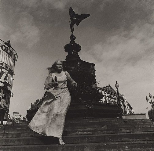 An image of Anna Lee in front of Eros statue, Piccadilly Circus, London by Lewis Morley