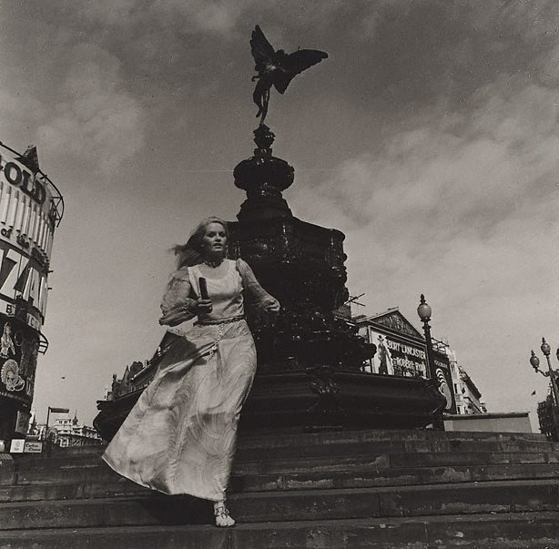 An image of Anna Lee in front of Eros statue, Piccadilly Circus, London