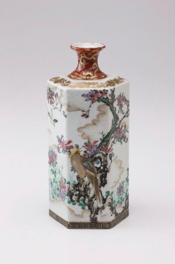 An image of Hexagonal bottle with bird and flower design
