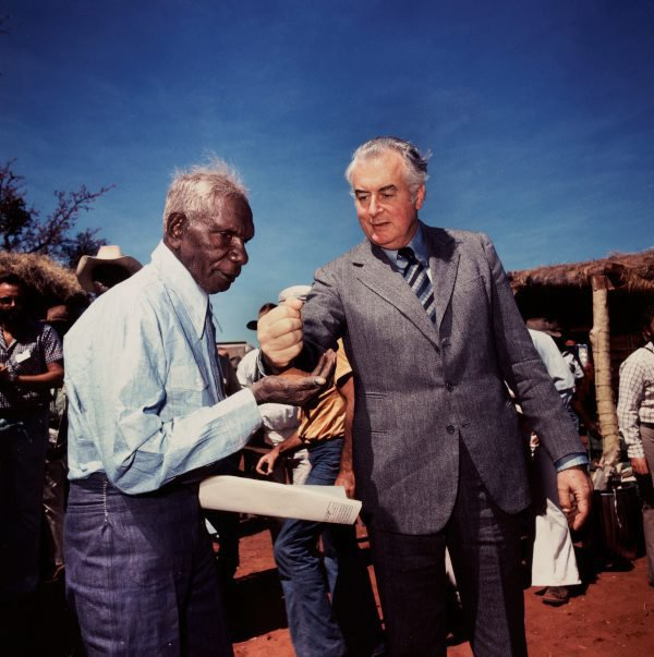 AGNSW collection Mervyn Bishop Prime Minister Gough Whitlam pours soil into the hands of traditional land owner Vincent Lingiari, Northern Territory 1975, printed 1999