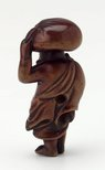 Alternate image of Netsuke in the form of Daikoku carrying a sack on his head by