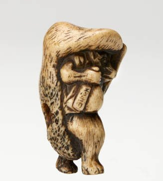 An image of Netsuke in the form of a tanuki (raccoon dog) carrying a 'sake' bottle