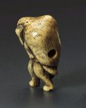 Alternate image of Netsuke in the form of a badger carrying a 'sake' bottle by