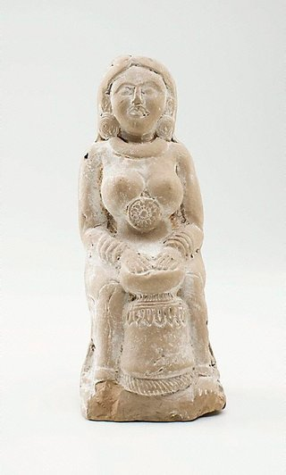 AGNSW collection Rattle in the form of a lady playing the drum 2nd century BCE-1st century BCE