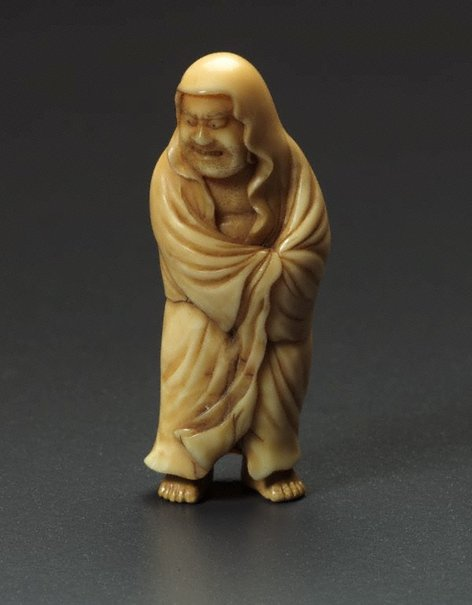 An image of Netsuke in the form of a standing Daruma by