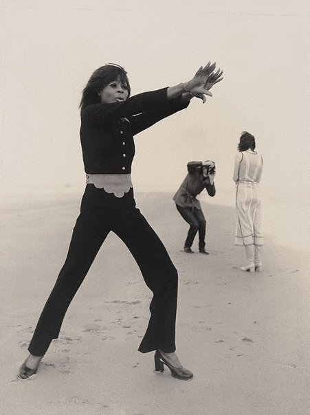 An image of Mynah Bird and Pete Smith on Camber Sands, England by Lewis Morley