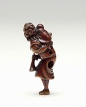 Alternate image of Netsuke in the form of a foreigner with a coat, carrying a child and a horn by