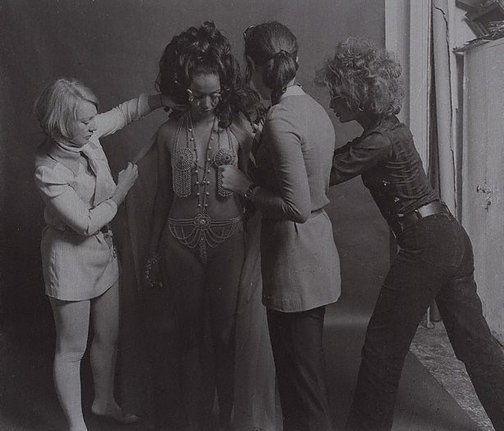 An image of Chain-mail fashion for 'She' by Lewis Morley