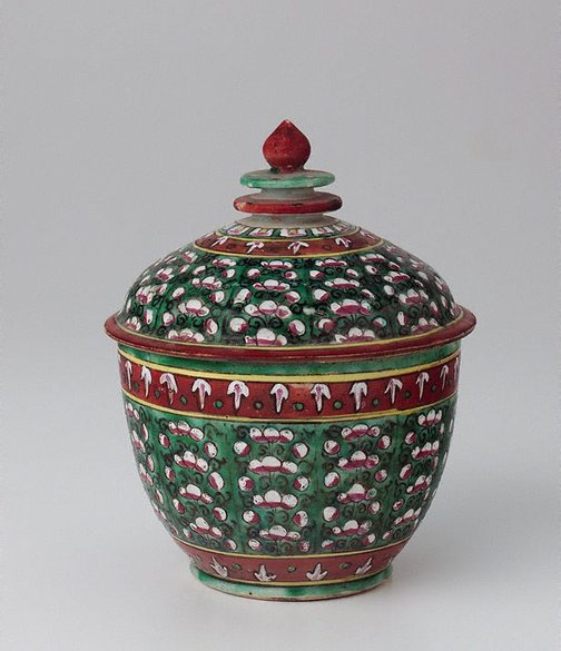 An image of 'Toh' jar decorated with coloured flowers in vertical patterns by Bencharong ware