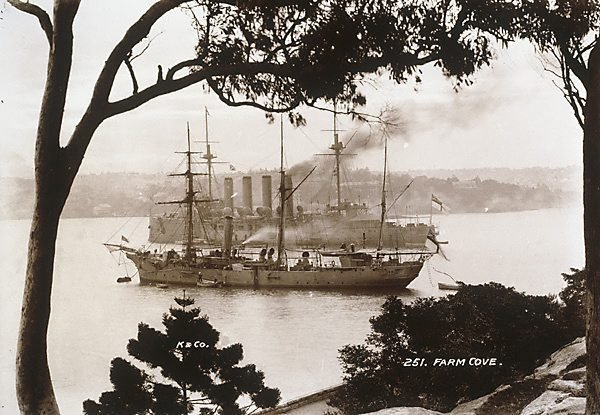 """An image of Farm Cove (H.M.A.S. """"Powerful"""" and H.M.A.S. """"Penguin"""") at anchor"""