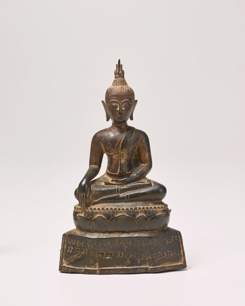 An image of Seated Buddha on inscribed plinth by