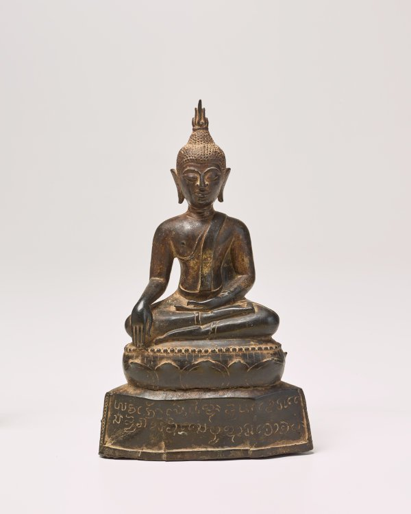 An image of Seated Buddha on inscribed plinth
