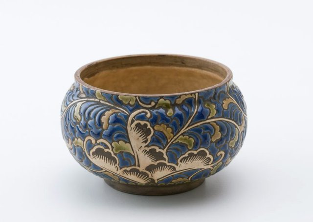 An image of Bowl decorated with leaves and flowers