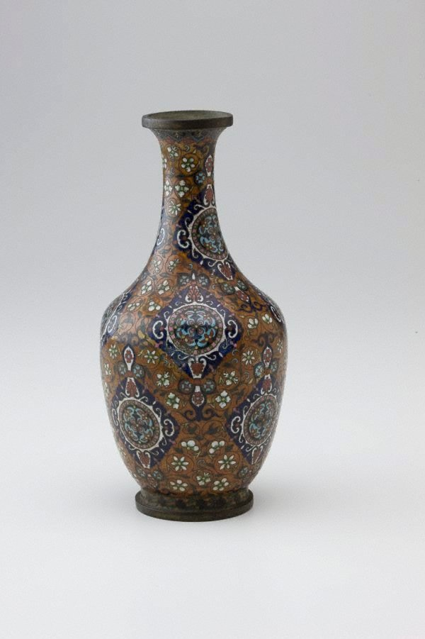 An image of Vase decorated with diamond shaped panels on a tan ground filled with scrolls