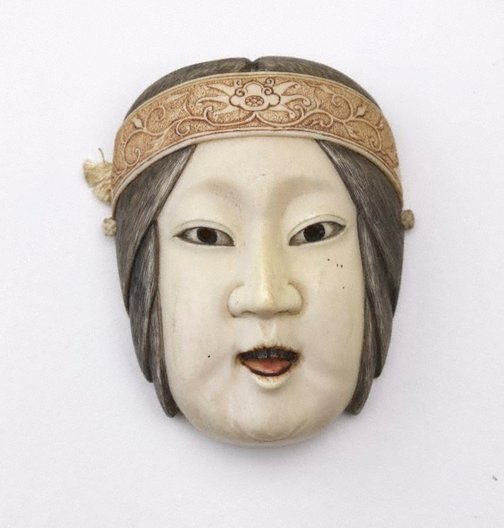 An image of Netsuke in the form of a female Nô mask by Tomotoshi