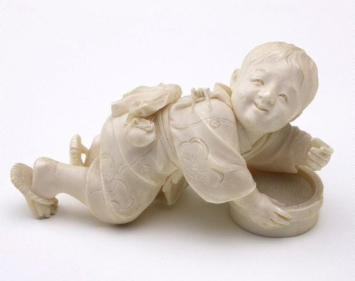 An image of Figure of a boy with a bamboo box (okimono) by Dôsai